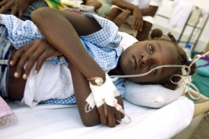 A Cholera outbreak originating in the Central Artibonite region of Haiti has killed around 250 people and effected over 2500 in the region.  A young girl with Cholera lies on a cot in the courtyard of the overcroweded L'Hopital St. Nicholas in St. Marc, the center of the Cholera epidemic, where Medecins Sans Frontiere and Cuban doctors are treating those infected.  Photo MINUSTAH/Sophia Paris