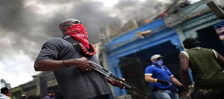 Haiti: Le Premier Ministre a.i. Jean Michel Lapin dénonce une guérilla dans les bidonvilles